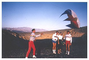 Flying a kite at the black covered extinct volcano